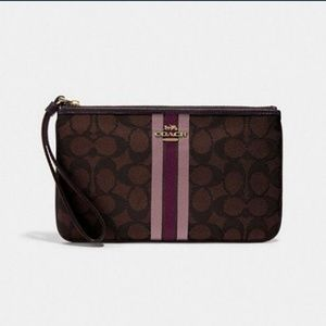 LARGE WRISTLET IN SIGNATURE JACQUARD WITH STRIPE